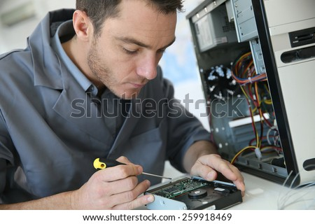 Technician fixing computer hardware - stock photo