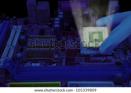 Technician hand installing the computer chip into a motherboard - stock photo