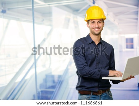 Technician Holding Laptop, Indoor - stock photo