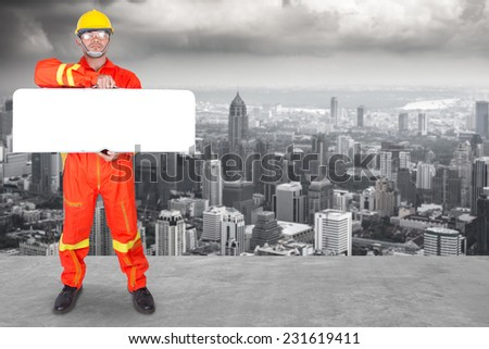 technician holding toolbox as blank white banner with copy space for your text working at high building construction site against urban scene balcony over looking city dusky before rain falling  - stock photo