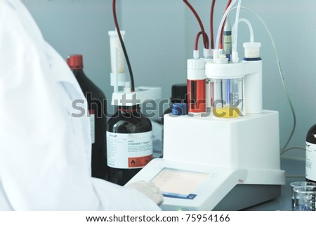 technician in lab use modern equipment - stock photo