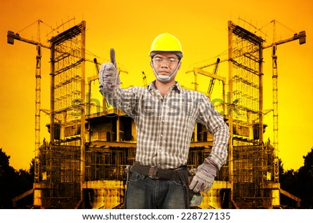 technician in protective safety equipment working at building construction site against beautiful sunset selective focus at eye