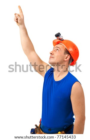 Technician in work wear point to the up against white background - stock photo