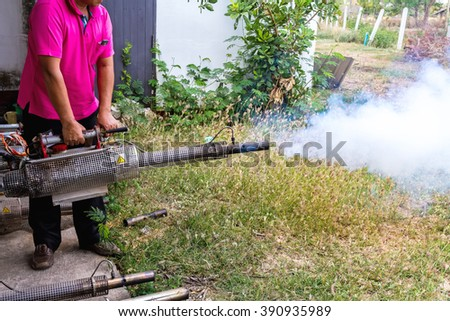 Technician man checking  of mosquito spraying machine to prevent of dengue fever for protection people