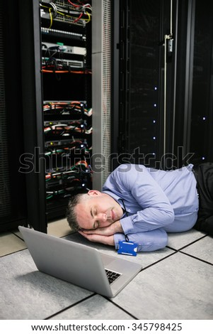 Technician napping in server room at the data centre