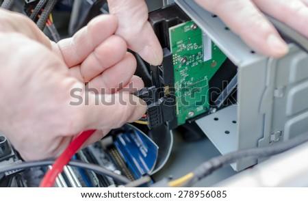 Technician repairing a computer - stock photo