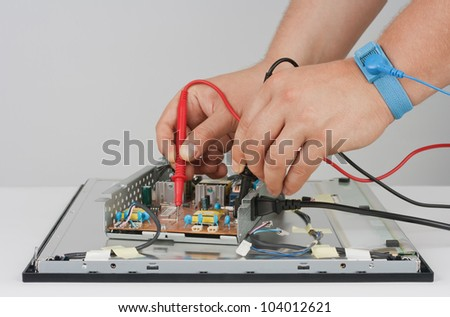 Technician repairing LCD Monitor. Objects photographed on a white background. - stock photo