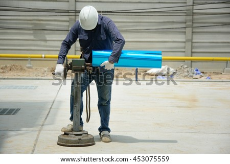 Technician rolling spiral stainless cover for protection pipe air compressor - stock photo