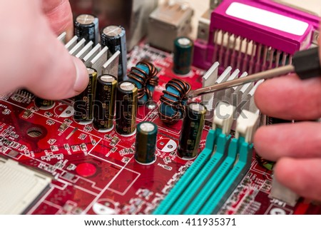 technician's hand assembling personal computer - stock photo