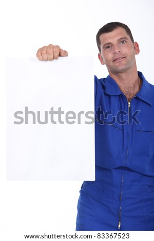 technician showing a piece of paper - stock photo