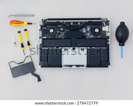 Technician support upgrade part and fixing laptop. - stock photo