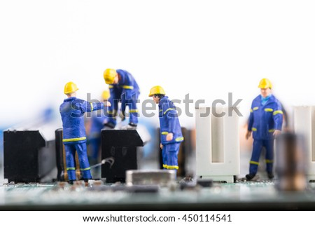 Technician team work repair and maintenance on board computer. - stock photo