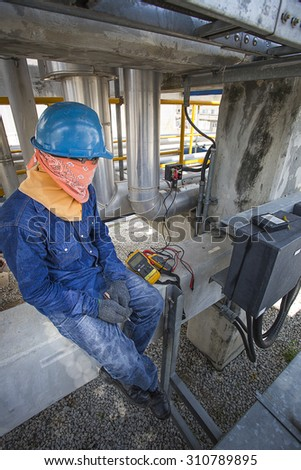 Technician to checking electrical cable in construction field
