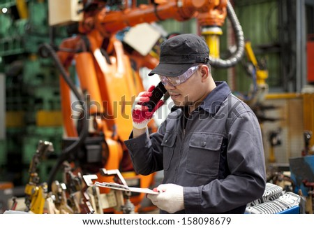 Technician with notepad communication via phone - stock photo