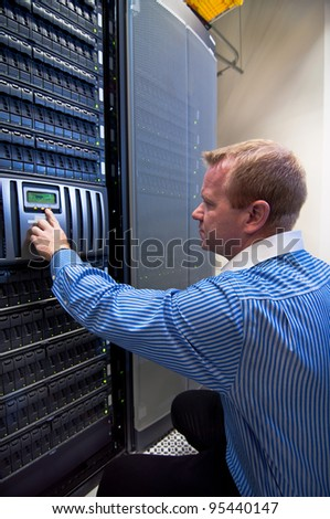 Technician working on a large scale Storage server (SAN/NAS).