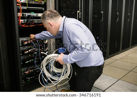 Technician working on broken server at the data centre