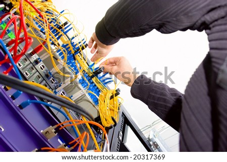 Technician working on server rack - stock photo