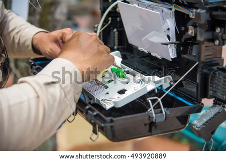 Technicians are install cabinet on fiber optic cable.