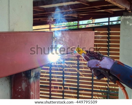 Technicians are welding steel structure roof.