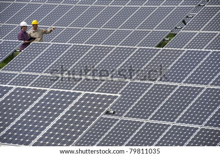Technicians inspection at Solar Power Station - stock photo