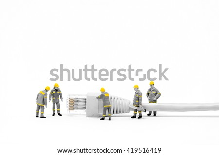 Technicians with cat5 network cable. Networking concept. Macro photo - stock photo