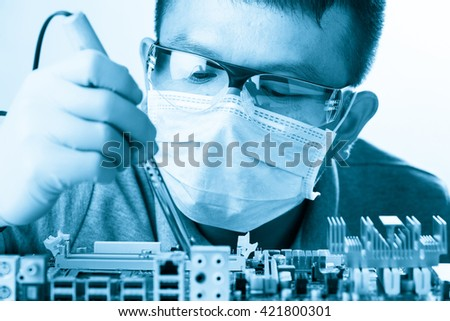 Technological background with closeup on tester checking motherboard. Electronics repair service, hands of female tech fixes an electronic circuit,computer technology concept