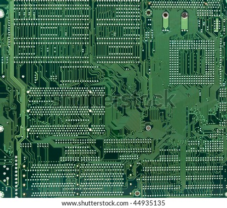 Technological industrial abstract background from circuit board in green color