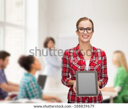 technology, advertisement, education and people concept - smiling girl in eyeglasses with blank tablet pc screen - stock photo