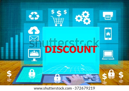 technology and biz concept. working on his laptop in the secured office, select icon discount on the virtual display - stock photo