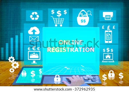 technology and biz concept. working on his laptop in the secured office, select  icon online registration  on the virtual display - stock photo