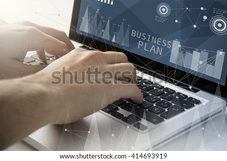 technology and business concept: man using a laptop with business plan software on the screen. All screen graphics are made up.