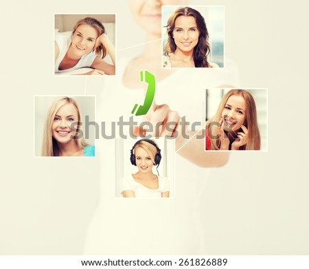 technology and communication - woman pressing button on virtual screen with contact icons - stock photo