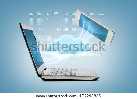 technology and internet concept - smartphone and laptop connecting