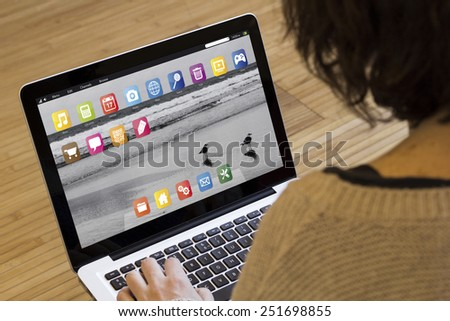 technology at home: close up view of woman using the computer - stock photo