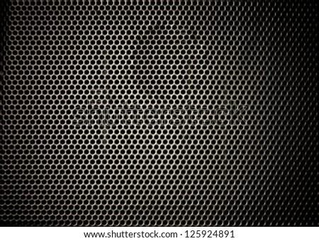 Technology background with  perforated carbon aluminum grill texture - stock photo