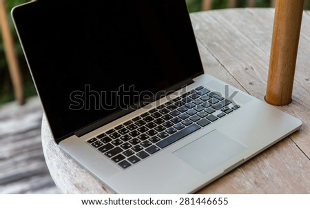 technology, business and modern life concept- close up of open laptop computer on table at hotel terrace - stock photo