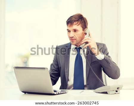technology, business, education and office concept - handsome businessman working with laptop computer, phone and documents - stock photo