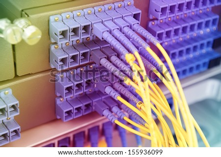Technology center with fiber optic equipment - stock photo