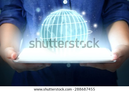 technology communication concept.  Hand women holding Globe from tablet pc. Touch pad interface - stock photo