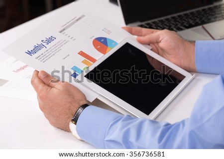 Technology Concept: Businessman using tablet pc