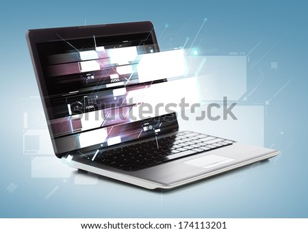 technology concept - laptop computer with virtual screens - stock photo