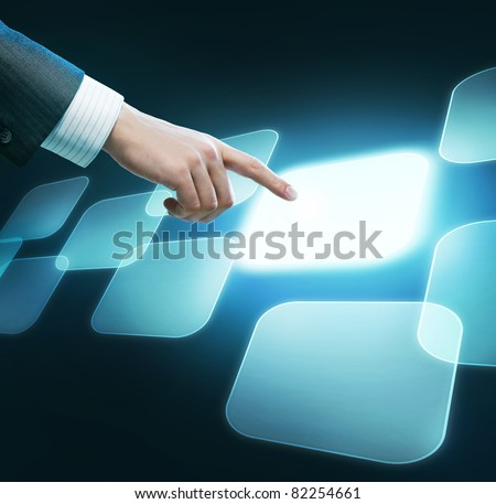 Technology concept. Man's hand pushing the button - stock photo