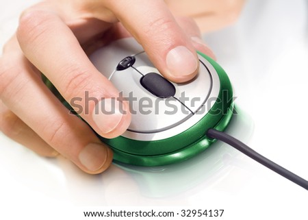 technology. green computer mouse with hand over white - stock photo