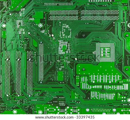 Technology: green motherboard surface. No logos or brandnames - stock photo