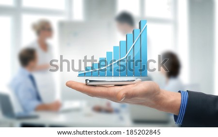 technology, internet and application concept - hand holding smartphone with virtual chart - stock photo