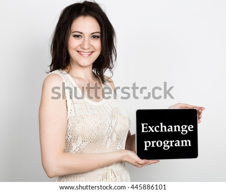 technology, internet and networking - close-up successful woman holding a tablet pc with exchange program sign. internet technology in tourism