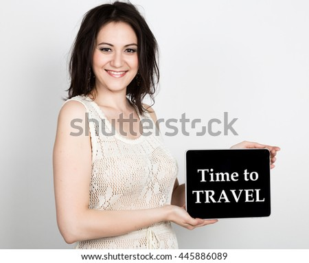 technology, internet and networking - close-up successful woman holding a tablet pc with time to travel sign. internet technology in tourism