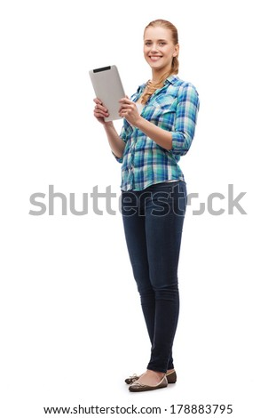 technology, internet and people concept - smiling girl with tablet pc computer