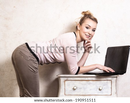 Technology internet modern lifestyle. Young businesswoman woman student girl working on computer laptop at the retro desk. Business at home.