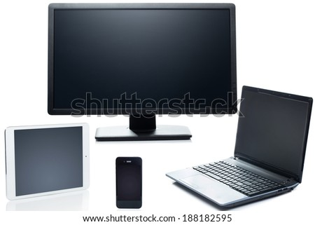 Technology. Laptop, tablet, smartphone and monitor on a white background - stock photo